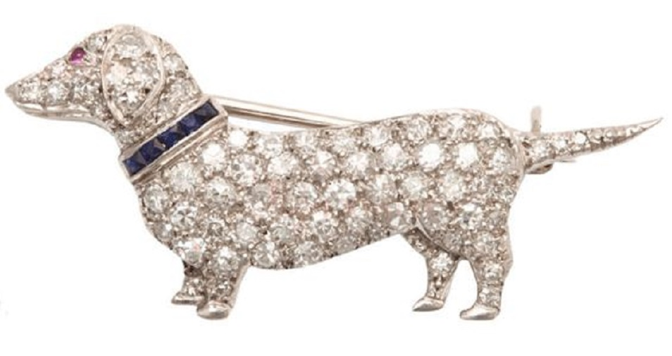 Art Deco Dachshund brooch by Cartier; platinum set with diamonds, sapphires, and rubies.